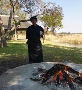 Margaret prepping coals for braai